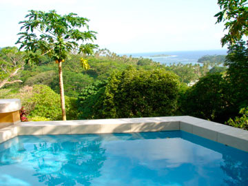 Swim in the ocean or relax poolside in your Rainforest Villa.