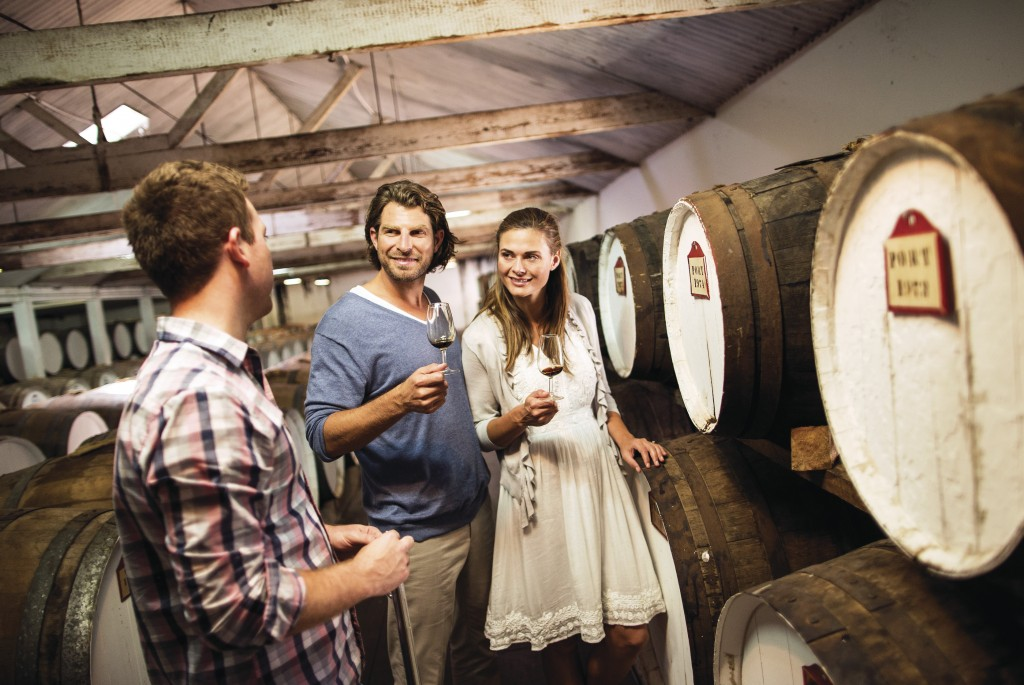 Couple enjoying tour of cellar door at Seppeltsfield Estate