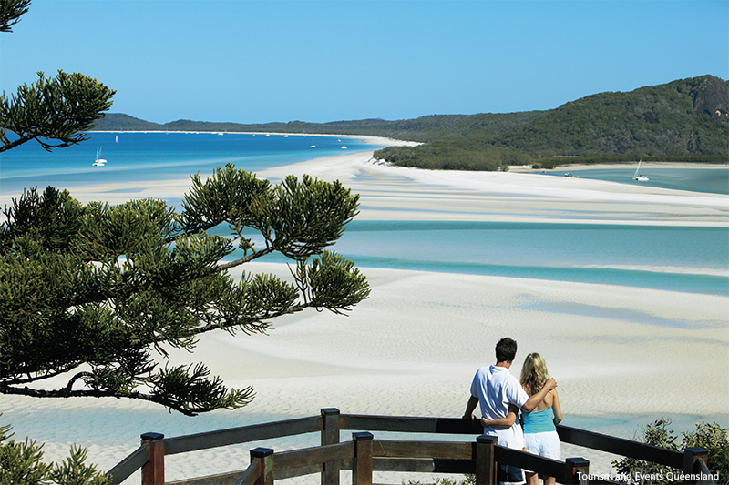 Couple looking out over Hill Inlet at Whitehaven Beach credit Tourism and Events Queensland