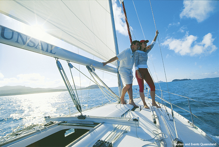 Couple on bow bareboating credit Tourism and Events Queensland