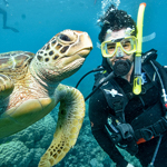 Scuba Diver posing with a sea turtle