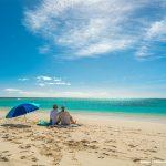 Couple sitting on the sands of Turquoise Bay, Ningaloo Marine Park credit Tourism Western Australia