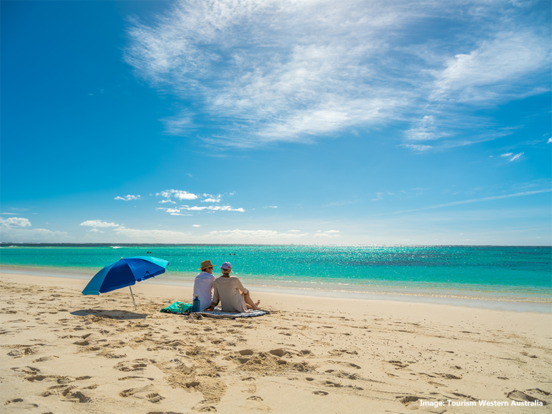 Couple sitting on the sands of Turquoise Bay, Ningaloo Marine Park credit Tourism Western Australia