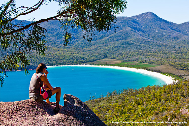 Woman looking out to Wineglass Bay, Freycinet National Park, Tasmania
