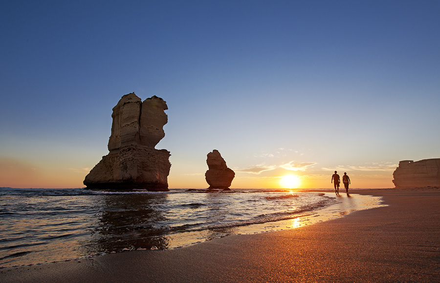 Couple hike past 12 Apostles on Australia Travel