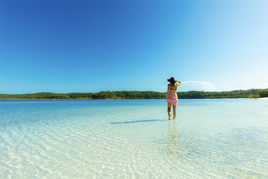 Girl standing in Lake McKenzie Fraser Island credit Jules Ingall