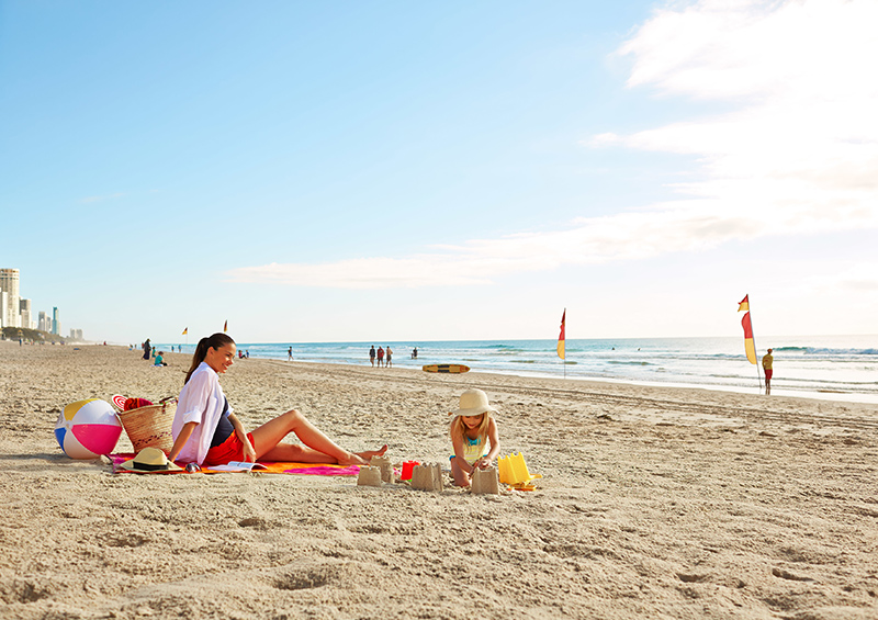 Family on the Beach in Gold Coast credit Tourism Australia and Tourism and Events Queensland